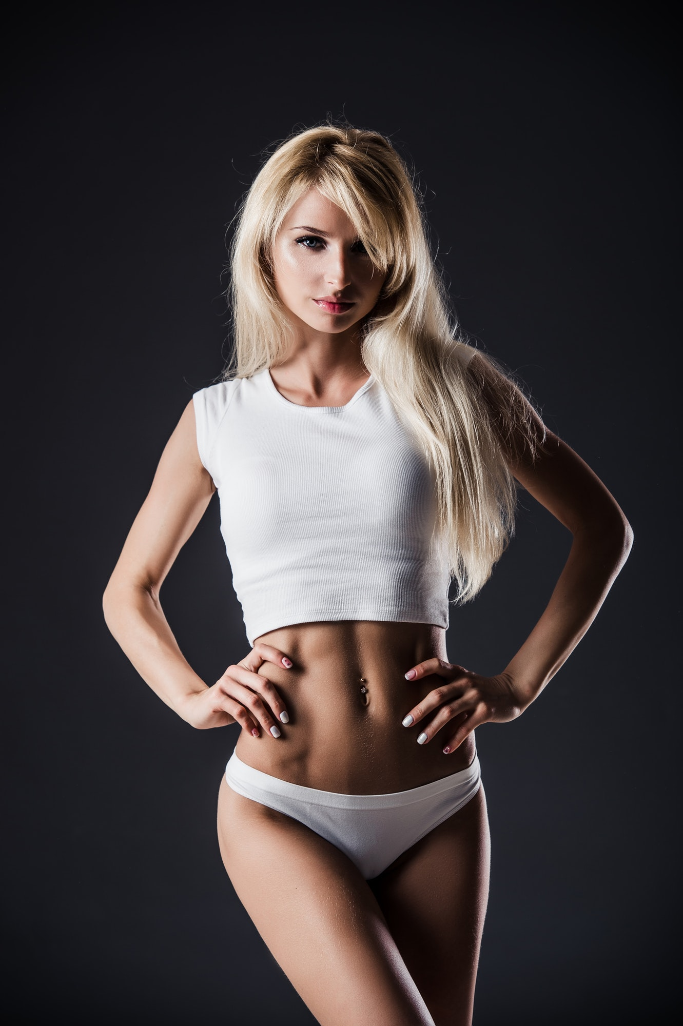fitness-blonde-woman-shows-her-body-fitness-motivation-perfect-female-sports-figure-fitness-woman.jpg